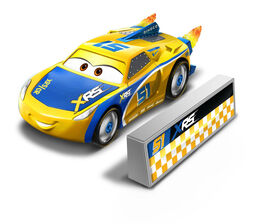 Disney/Pixar Cars XRS Rocket Racing Cruz Ramirez with Blast Wall